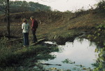 Man and Woman Standing On Cleared Land near the Little Tennessee River